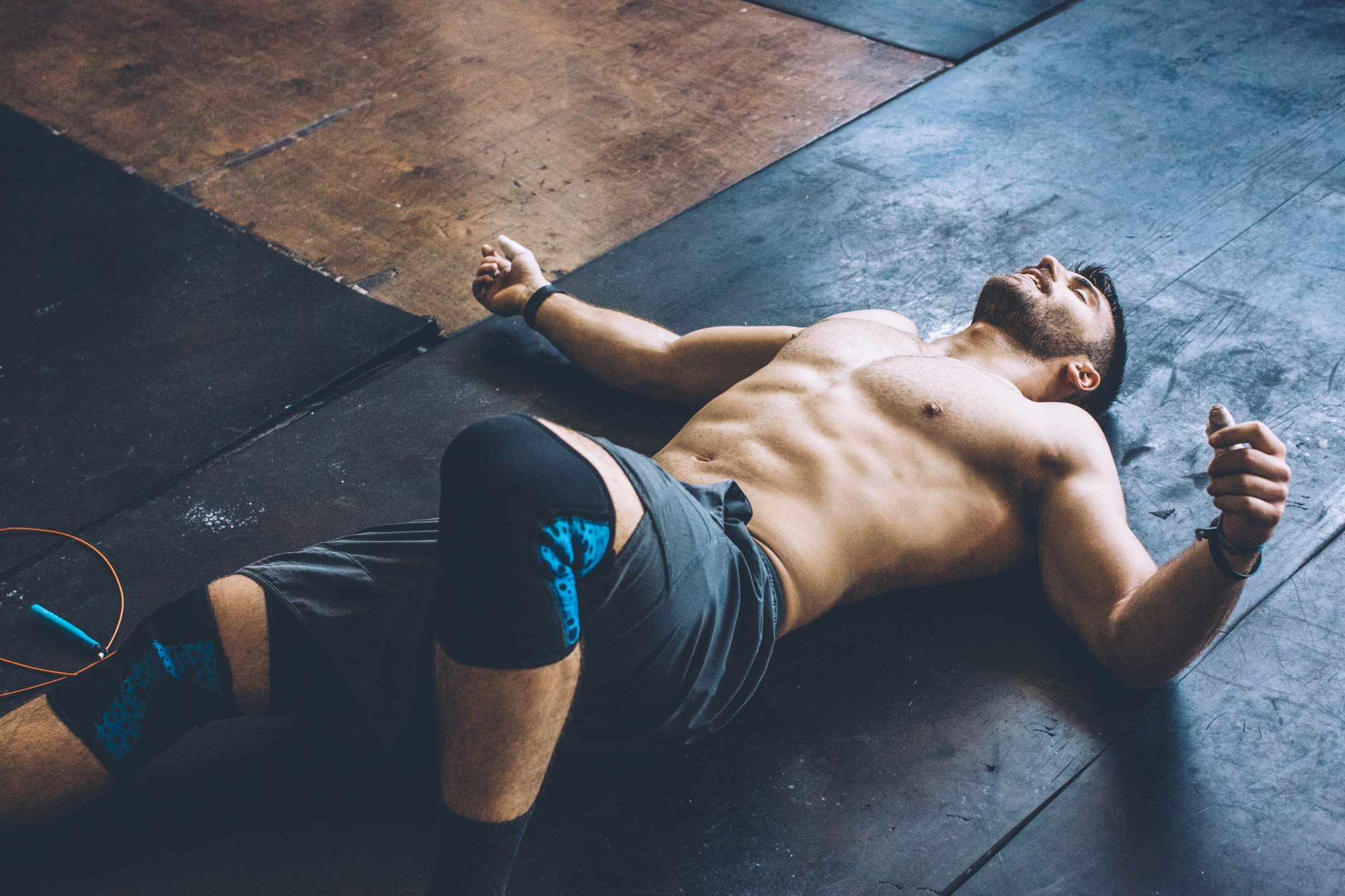 Young athlete resting in gym after hard cross training.