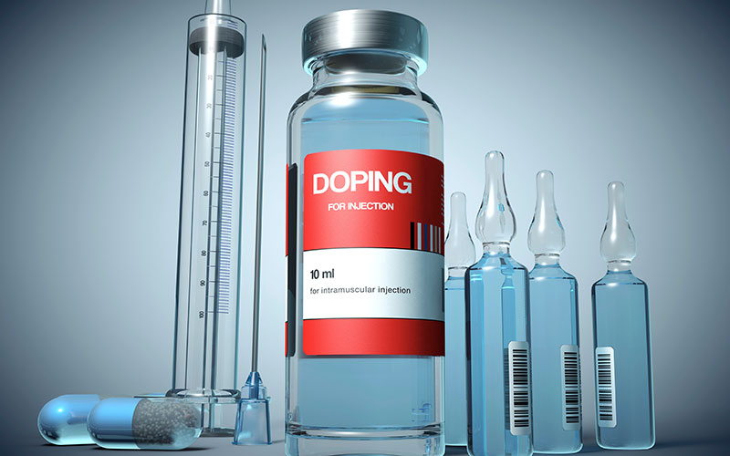 Several bottles, syringes and ampoules labeled with DOPING.