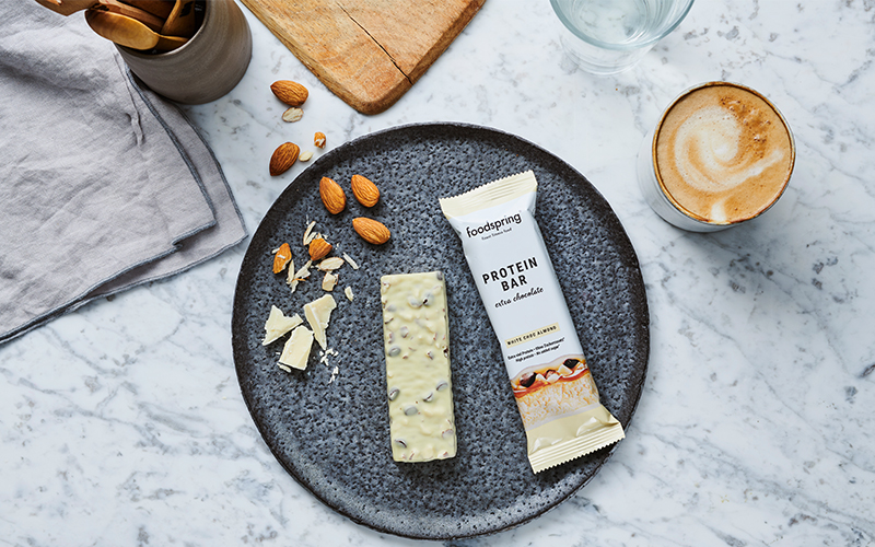Lose weight without hunger by filling up on protein. Try one of our delicious extra chocolate protein bars as pictured here on a slate-colored plate!
