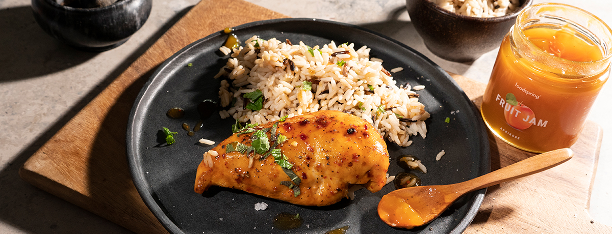 A plate with an apricot-glazed chicken breast and wild rice