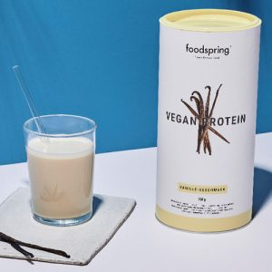 a canister of vanilla-flavored vegan protein powder