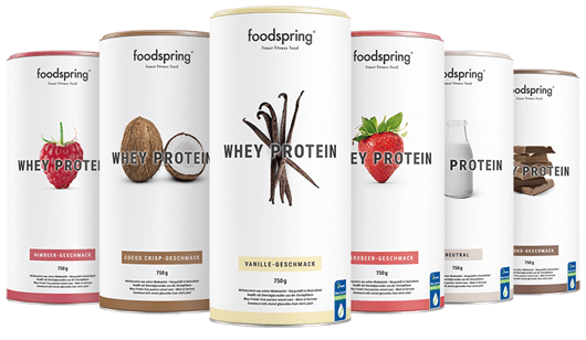 A selection of canisters of whey protein powder by foodspring